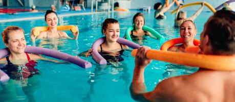 community members doing aqua aerobics in a pool