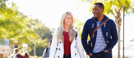 Young man and woman walking on a university campus