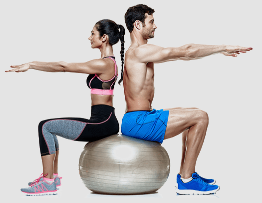 a man and woman sitting back-to-back on a fitness exercise ball and doing arm stretches