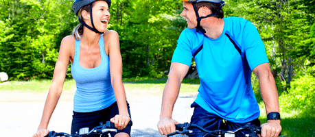 man and woman biking in a park