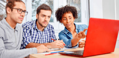man and woman working on SEO strategy over a laptop
