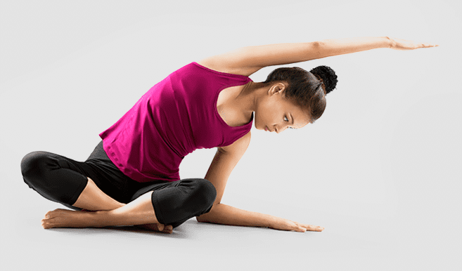 young woman practicising yoga